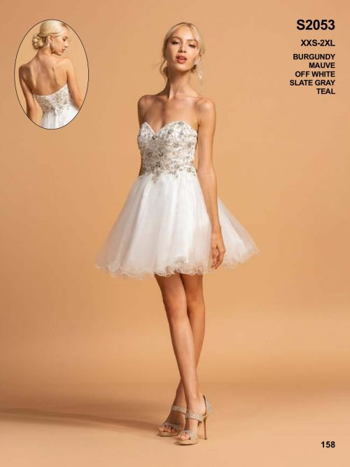 Blonde women wearing a Aspeed Design Dress Style S2053 shown in white. Stunning Strapless tulle dress with full skirt and embellished sweetheart bodice from Prom Dress Specialists, Silhouette London