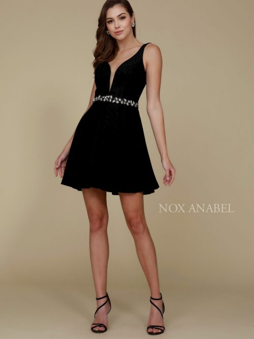Young women wearing a Nox Anabel Dress Style 6241 in Black. Fabulous plunge neck crepe Skater dress with stunning embellished waistband from Prom dress specialists Silhouette London.