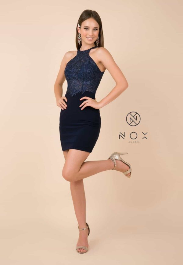Young women wearing a Nox Anabel Dress Style E697 in Navy. Bodycon Dress with embellished lace halter neck bodice and jersey fitted skirt from Silhouette London, specialist dress boutique in London
