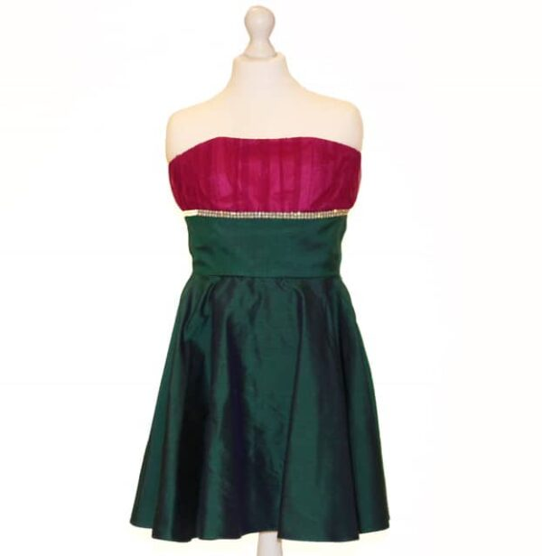 Love Story Strapless Taffeta dress. Taffeta dress with tulle ruched strapless bodice in a stunning fuschia with diamante detail with a midnight green taffeta skater body and skirt from Silhouette London, Girls Dress specialist in London