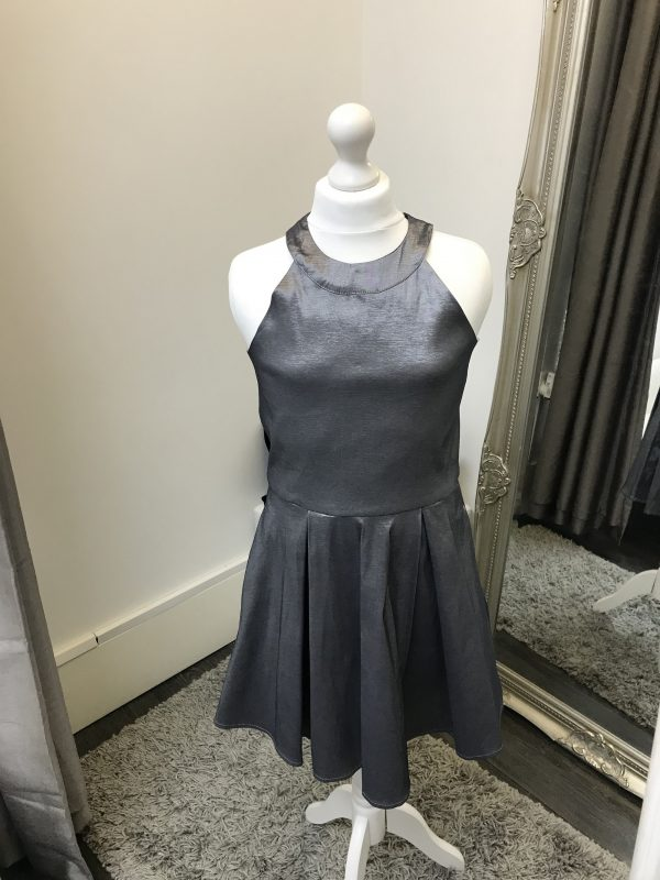 Sally Miller Platinum Dress in Dark Silver. High necked shimmer halter dress with full skirt and racer back from Silhouette London, Girls party dress specialists in London