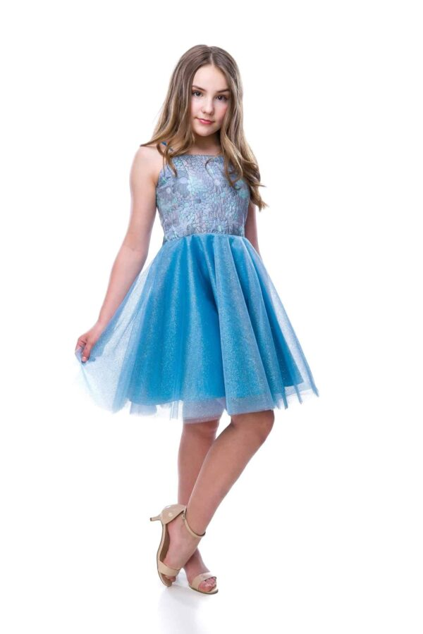 Young girl wearing a Un Deux Trois Jacquard Tulle Dress. Fabulous blue and lilac shimmer jacquard tops a stunning full tulle glitter skirt from Silhouette London, Girls party dress specialists in London