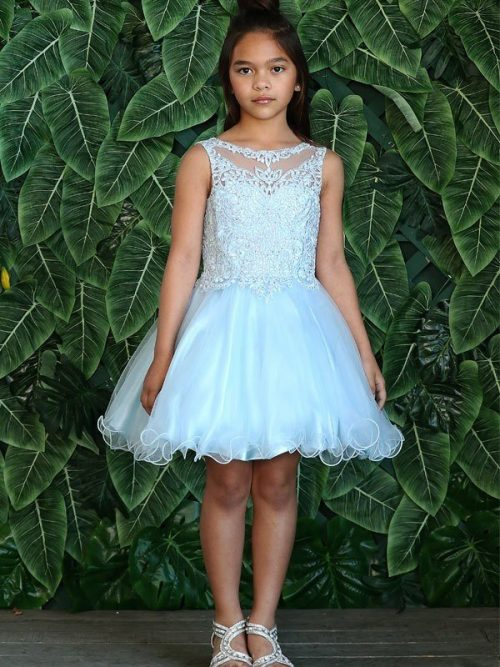 Young girl wearng a Calla Collection Dress TY014 in Light Blue. Stunning crystal embellished lace bodice with full tulle skirt with scalloped edge from Silhouette London, Girls party dress specialists in London
