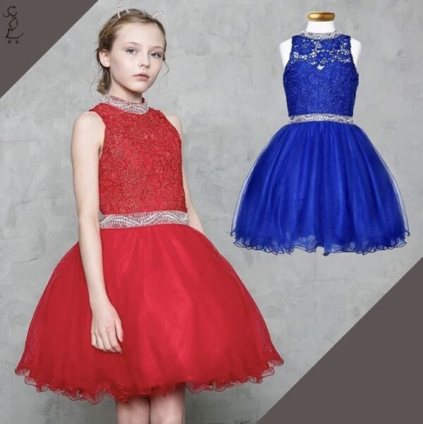 Young girl wearing a Calla Collection Dress TY007 in Royal Blue. Fabulous lace bodice with beautiful embellished waistband and neckline with tulle scalloped edge skirt from Silhouette London, Girls party dress specialists in London
