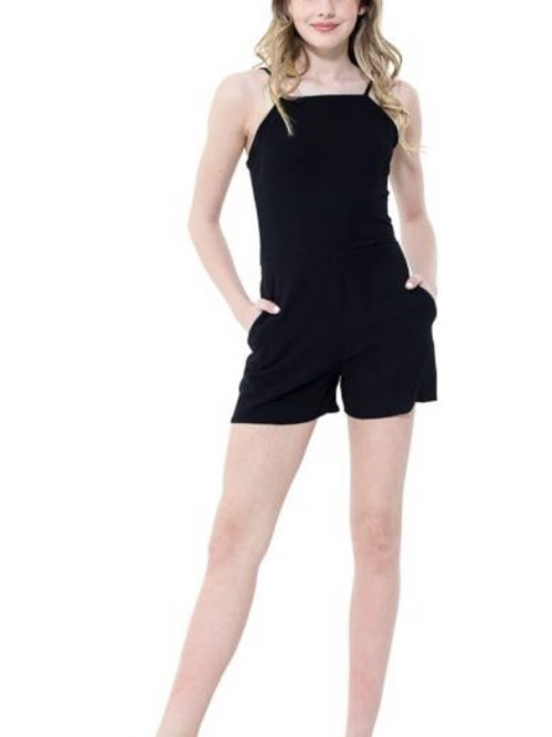 Teenage girl wearing a Miss Behave Reese Black Playsuit in Balck. Crepe playsuit with spaghetti straps from Silhouette London, girls party dress specialist London
