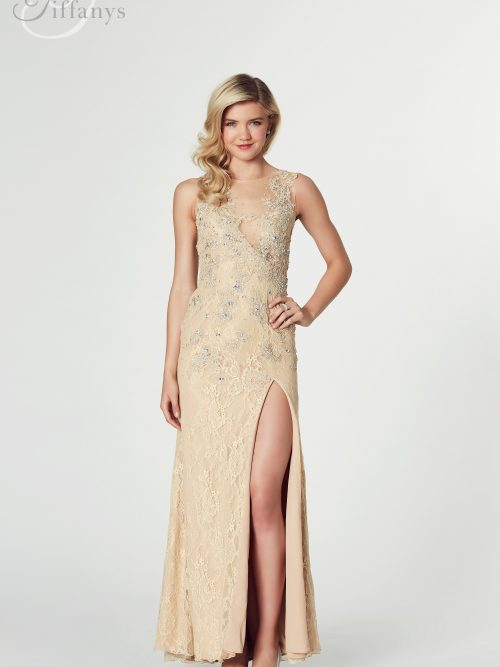 Blonde girl wearing a Tiffany Illusion Prom Cassie Dress in Nude. Stunning nude lace and mesh dress with scattered crystals throughout, from Prom Dress Boutique Silhouette London.