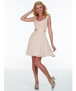 Young woman wearing a Christina Wu Party Dress 22587 in Ivory from Prom Dress Boutique Silhouette London.