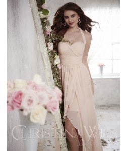 Brunette teenage girl wearing a Christina Wu Dress Style 22700 in Petal Pink. Hi-Lo pleated chiffon dress with tulip skirt from Prom Dress Boutique Silhouette London.