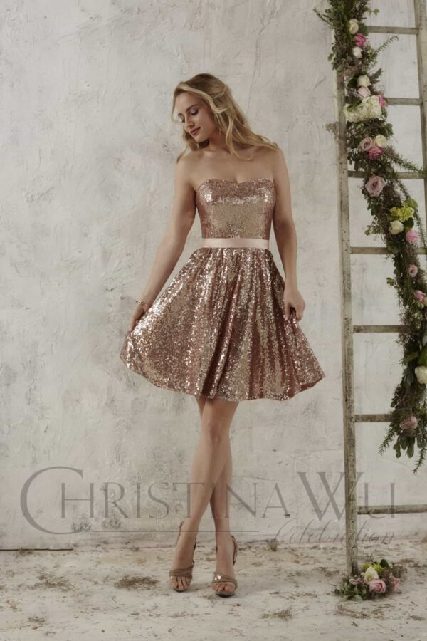 Young teenage girl wearing a Christina Wu Dress Style 22707 in Rose Gold. Strapless Sequin Party/Bridesmaid dress with straight bodice from Prom Dress Boutique Silhouette London
