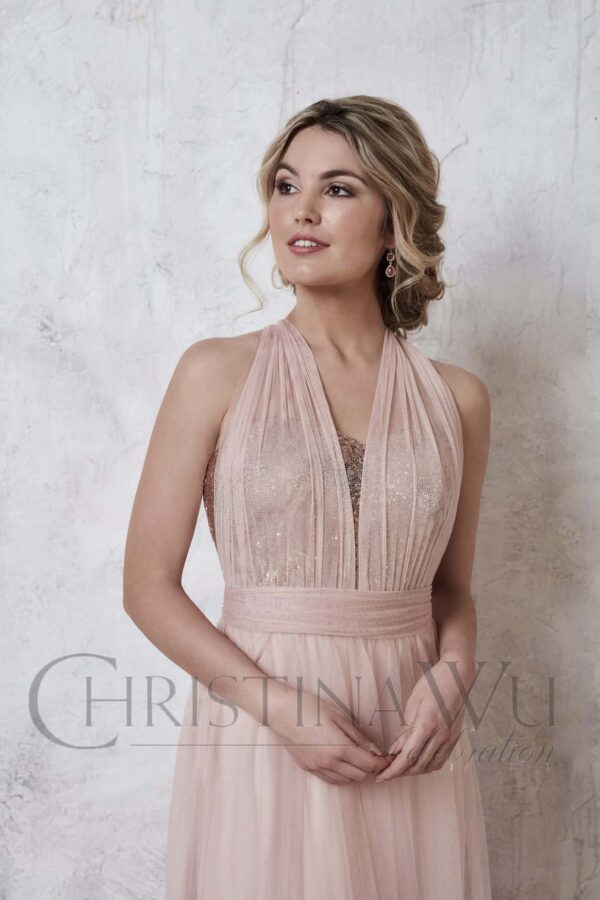 Young blonde women wearing a Christina Wu Dress Style 22725 from Prom Dress Boutique Silhouette London.