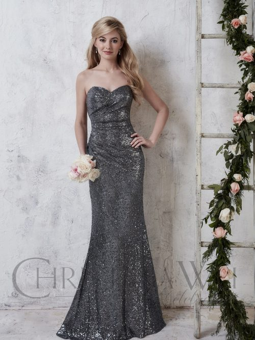Model wearing a Christina Wu Dress Style 22726 in matt Aubergine sequins, from Prom Dress Boutique Silhouette London.