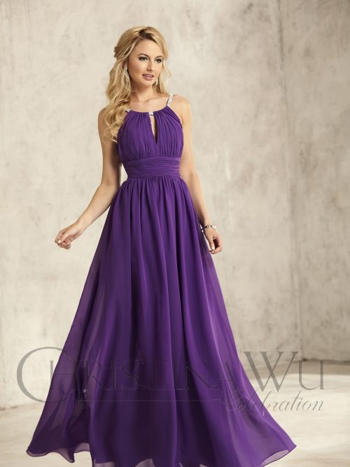Blonde hair women wearing a Christina Wu Dress Style 22743 shown in purple. Long dress with pleated halter neck kehole bodice and jewelled halter neck strap, pleated waistband and floaty chiffon skirt from Prom Dress Boutique Silhouette London.