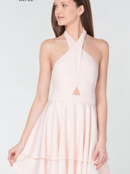 Teenage girl wearing a Alyce Paris Dress Style 33100 in Blush Pink. Halter jersey skater dress with keyhole detail and open back from Specialist Dress Boutique Silhouette London