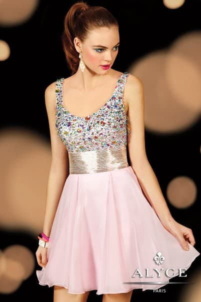 Young woman wearing an Alyce Paris Dress Style 3592 shown in Pink with beaded bodice adorned with beautiful beading and flirty chiffon skirt from Silhouette London, Girls party dress specialists in London.