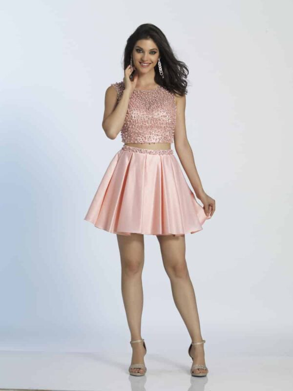 Young brunette wearing a Dave and Johnny Dress Style A4519 Blush Size 0. Two Piece with pearl embellished bodice and skater style skirt from Silhouette London, Girls party dress specialists in London.