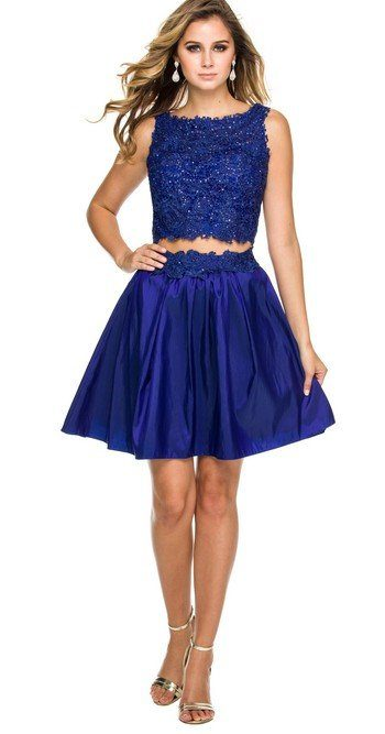 Young Woman WearingNox Anabel Two Piece Dress Style 6054 Embellished Lace Top and Taffeta Pleated Skater Skirt in Royal Blue from Party Dress Boutique Silhouette London