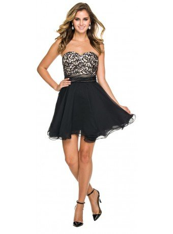 Young Woman Wearing Nox Anabel Party Dress Style 6169 Black on Nude Lace sweetheart strapless bodice with black floaty chiffon skirt from Party Dress Boutique Silhouette London