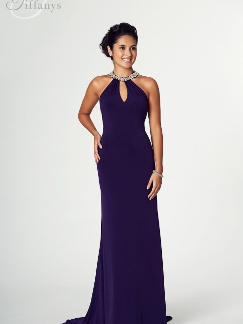Young women wearing a Tiffany Illusion Prom Abbie Dress in Purple. Long dress with a keyhole halter bodice with jewels at the neckline from Prom Dress Boutique Silhouette London.
