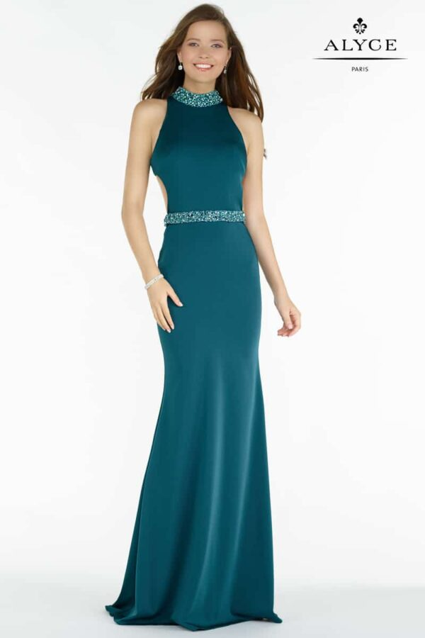 Teenage model wearing a Alyce Paris Prom Dress Style 8007 in Forest. Stretch crepe slim gown with a halter top embellished at the waist and neck, open mid back with thick straps from Prom Dress Boutique Silhouette London.