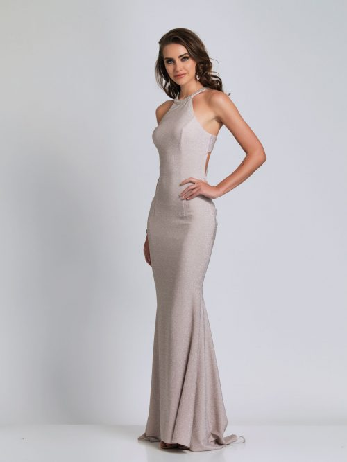 Young woman wearing Dave and Johnny Long Prom Dress Style A8626 halter neck bodice with embellished detail at the neckline and back in Silver shimmer from Prom Dress Boutique Silhouette London.