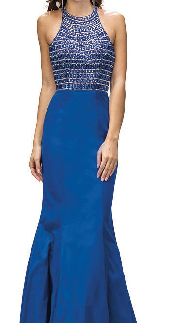 Brunette teenage girl wearing a Dancing Queen Prom Dress Style 9355 Royal Blue. Fabulous Halter neck crystal embellished bodice with T bar zip closing at the back, tops a gorgeous mermaid style satin skirt from Prom Dress Boutique Silhouette London.