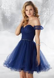 Teen Girl wearing Mori Lee Party Dress Style 9485 pleated sweetheart strapless neckline with detachable bardot sleeves and full tulle skirt in Navy from Batmitzvah Dress Speciaist Boutique Silhouette London