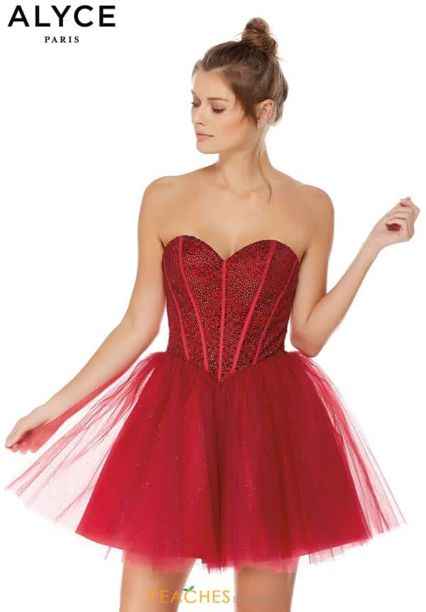 Brunette model wearing a Alyce Paris Dress Style 3755 in Claret. Stunning embellished corset style bodice with tie up corset closing with full straight edged glitter tulle skirt from Prom Dress Boutique Silhouette London