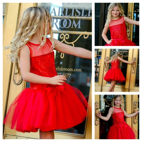 Young girl wearing Dolls and Divas Couture Amy 10 Dress in red sequins and tulle with matching satin bow from Silhouette London, the destination boutique for girls party fashion in Greater London.
