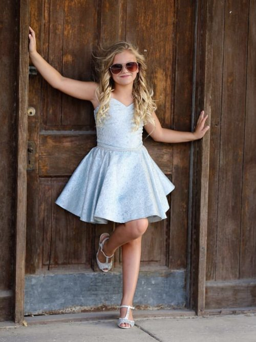 Teenage Girl wearing a Dolls and Divas Couture Aspen Strapless dress in Blue and Gold Brocade from Silhouette London, a Batmitzvah Dress Specialist Boutique in Greater London