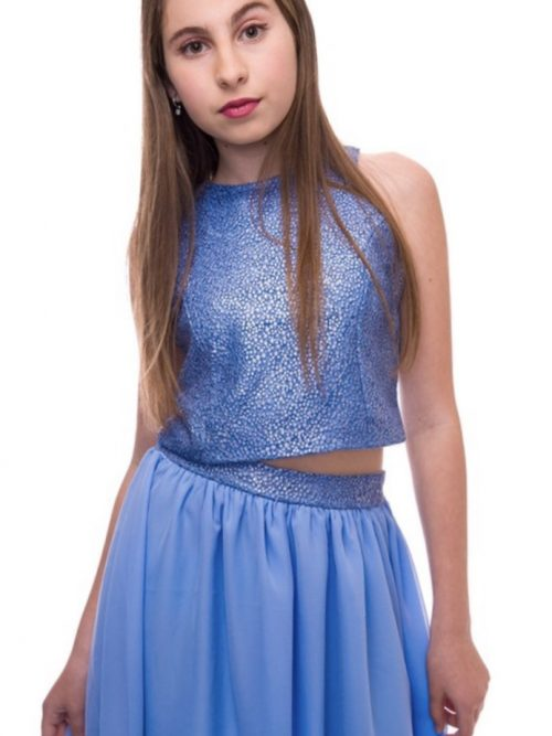 Brunette girl wearing a Un Deux Trois Blue Sequin Top in Soft mid Blue. Fabulous high necked sequin vest top with soft back from Silhouette London, Girls party dress specialists in London.