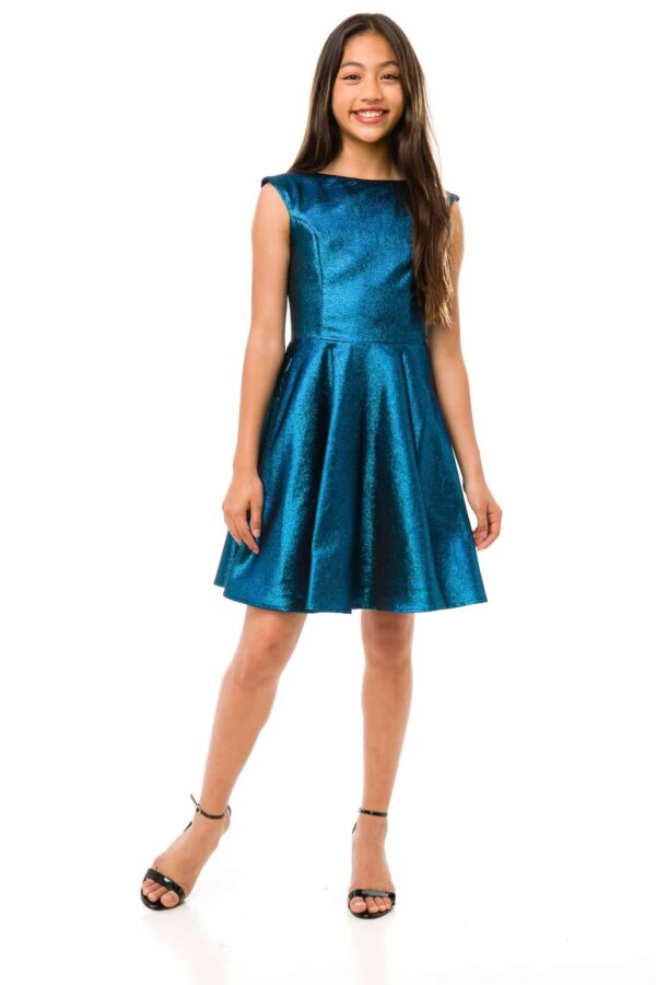 Teenage model wearing a Un Deux Trois Shimmer Cap Sleeve Dress in Peacock Blue, from Silhouette London, Girls Party Dress Specialist in London