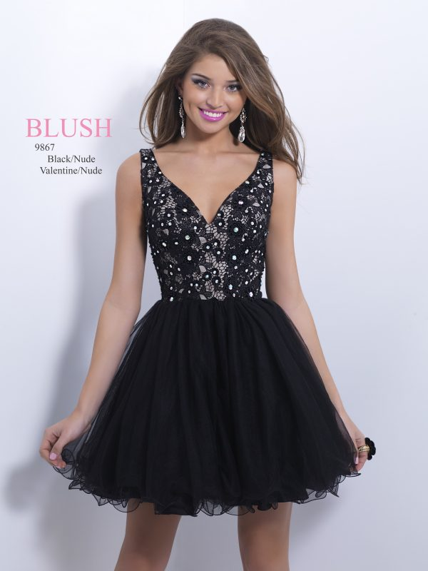 Young girl wearing a Blush Prom Dress Style 9659 in black. Beautiful lace bodice, tulle skater style skirt and side zip fastening from Prom Dress Boutique Silhouette London.