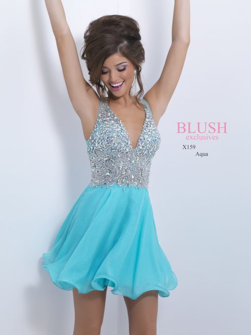Brunette teenage girl wearing a Blush Prom Dress Style X159 in Aqua. An embellished plunge neck bodice with zip fastening and V back and flowing chiffon skirt from Silhouette London, Girls party dress specialists in London.