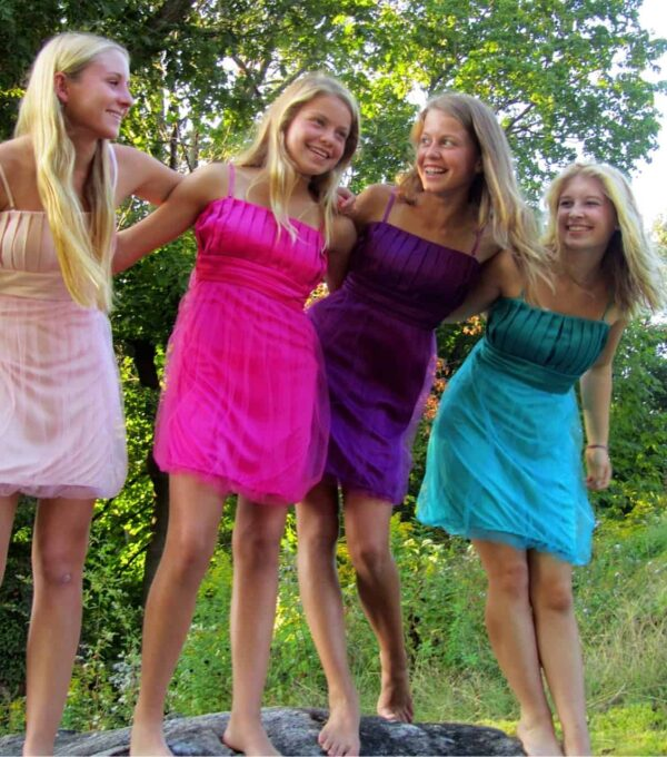 Youngs girls wearing Stella M'Lia Anna Dress's in various colours from Silhouette London, Girls party dress specialists in London