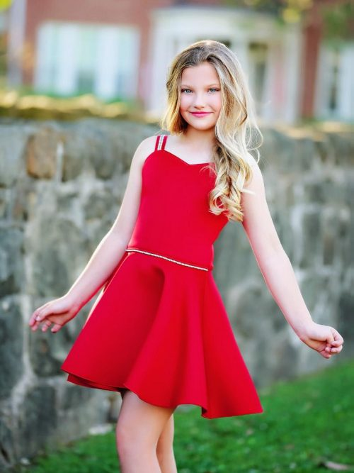Young Girl wearing a Dolls and Divas Couture Ella 6BIS sweetheart skater dress in Red Scuba from Silhouette London, a Girls Party Dress Boutique in Greater London
