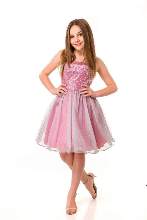 Teenage Girl wearing anUn Deux Trois Strapless Hot Pink and Silver Sequin and layered Tulle Dress from Silhouette London, Batmitzvah Dress Specialist Boutique in Harrow, Greater London