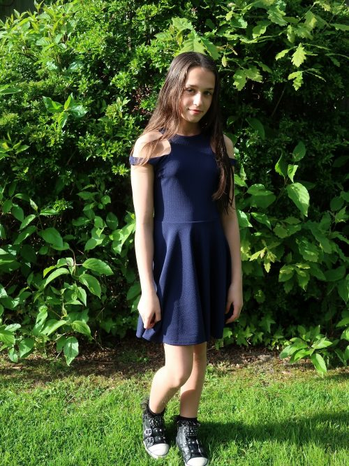 Young Girl wearing Navy Cut Shoulder Skater Dress Navy Jersey Skater dress from Silhouette London, Girls Party Dress Boutique in Harrow