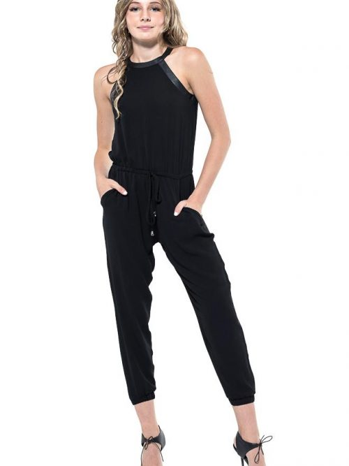 Teenage Girl wearing a Miss Behave Joyce Black stretch crepe halter neck jumpsuit with faux leather trim and a gathered leg from Silhouette London a Teen Prom and Party Fashion Boutique in Greater London