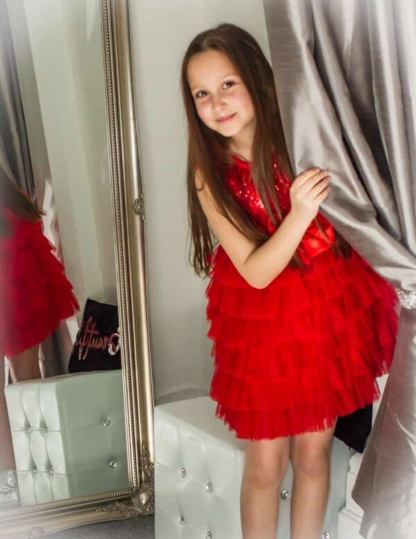 Young Girl wearing Sequin and Tulle Dress with tiered skirt in Red Age 10-12 from Silhouette London a Girls Party Boutique in Greater London