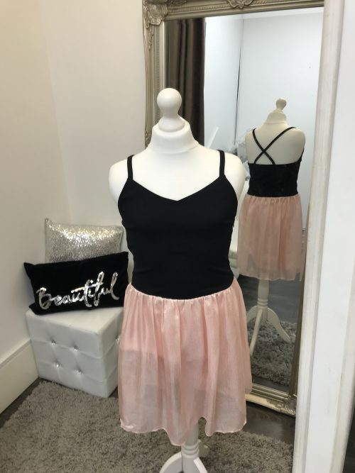 Mannequin wearing a Sally Miller Alexandra Dress with a Black jersey bodice and a Pink chiffon style skirt from Silhouette London a Teen Party Dress Boutique in Greater London