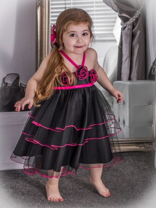 Young Girl wearing Multi Layer tulle floral Style 304 in Black/Fuschia from Silhouette London, a Girls Party Dress Boutique in Greater London