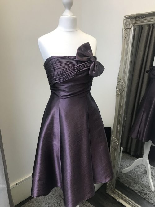 Fabulous taffeta dress with pleated top with matching bow and full skater skirt from Prom Dress Boutique Silhouette London.