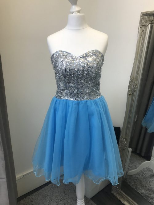AB Crystal and Tulle Dress in turquoise. Irridescent crystals adorn this sweetheart bodice with corset closing and full turquoise tulle skirt with scalloped edge from Silhouette London, Girls party dress specialists in London