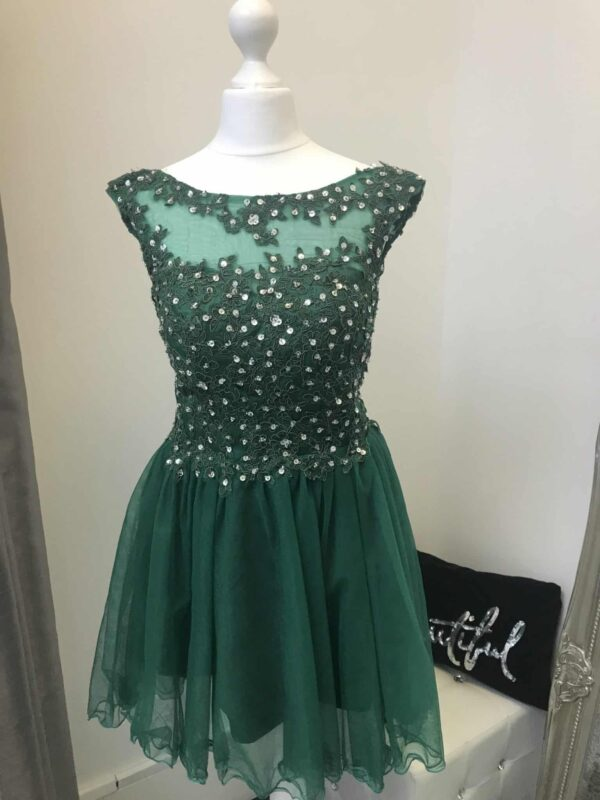 Full Lace Bodice and tulle skirt in Emerald. Illusion neckline, sequin embellished lace bodice and corset closing with full tulle scalloped edge skirt from Silhouette London, Girls party dress specialists in London.