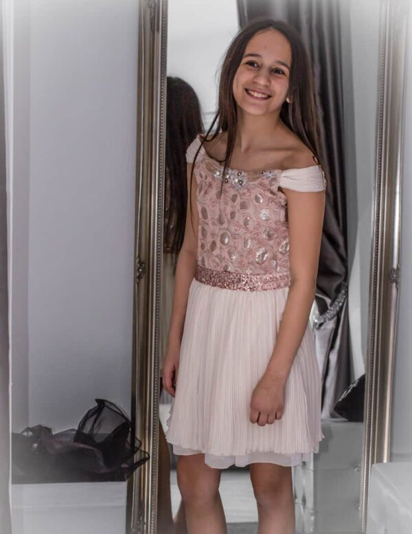 Model wearing Elisa B Ivory embroidered dress from Silhouette London, Girls party dress specialists in London