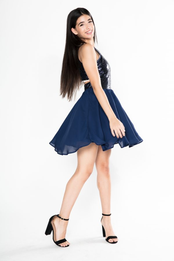 Teenage Girl wearing Miss Behave Girls Josie Dress in Navy Sequin Bodice and Chiffon Skater Skirt with cut out back from Silhouette London, a Girls Party Fashion Boutique in Greater London