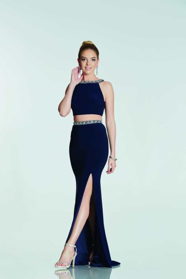 Brunette model wearing a Tiffany Illusion Prom Kim Two Piece in Navy. Heavy Jersey Halter neck two piece with stunning beading around the neck and waistband from Prom Dress Boutique Silhouette London