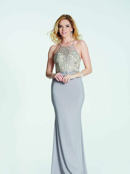 Blonde girl wearing a Tiffany Illusion Prom Madison Dress in Stone. Crystal encrusted halter neck bodice with strappy back detail and fitted jersey skirt from Prom Dress Boutique Silhouette London