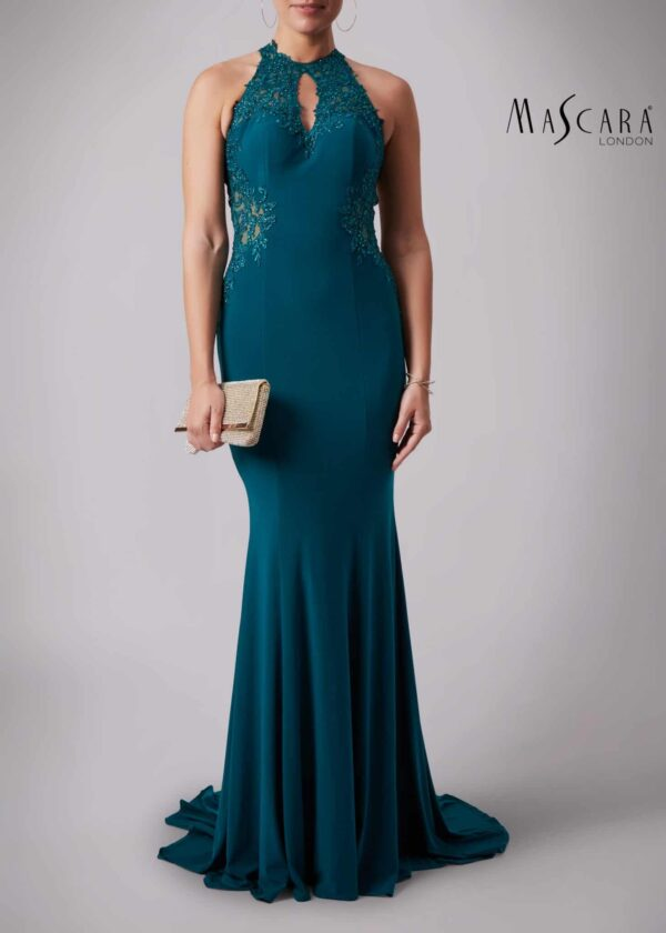 Young woman wearing a Mascara Collection Style MC181359G Lace and Jersey Long Prom Midnight Green Dress from Prom Dress Boutique Silhouette London.