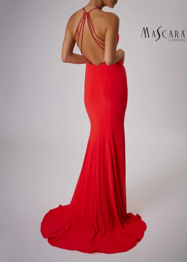 The back of a young woman wearing a Mascara Collection Style MC181360G Jersey Halter Neck Long Dress with Sparkle Strap Back Detail in Red from Prom Dress Boutique Silhouette London.